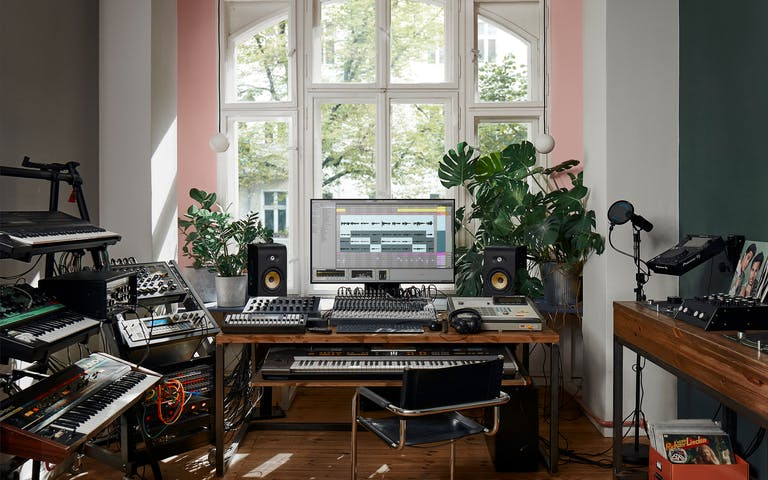 Sunny home studio setup with Live 11 and a collection of synthesizers